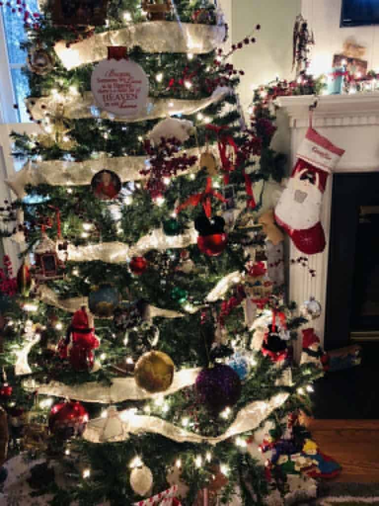 decorating your Christmas tree with memories as part of a family Christmas tradition. Every year decorate it differently with new memories made the past year
